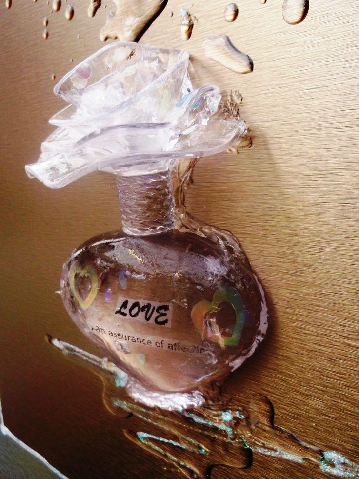 3D Perfume bottle on bronze metal
