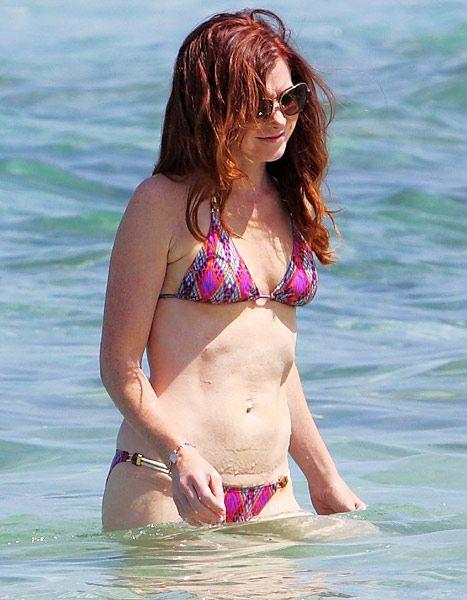 Alyson Hannigan wows in a pink string bikini in Hawaii