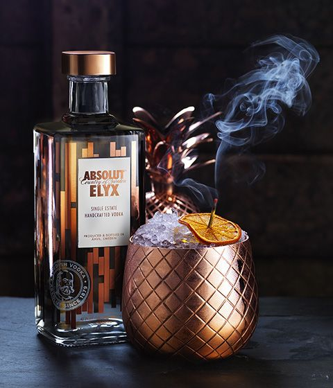 Absolut Elyx - Orchard Cocktail Ingredients: 2 oz. Elyx 2 oz. Passion Fruit Puree or Fresh Pulp 1 oz. Fresh Pineapple Juice 1 oz. Freshly Squeezed Lime Juice 1 oz. Agave Syrup 2 Pinches Cayenne Pepper 2 Kafflir Lime Leaves Vessel: Elyx Original Copper Pineapple Garnish: Dried Whole Chilli and Passion Fruit Preparation: Muddle kaffir lime leaves, add other ingredients. Shake and strain into copper pineapple over cubed ice. Cap with crushed ice and garnish.