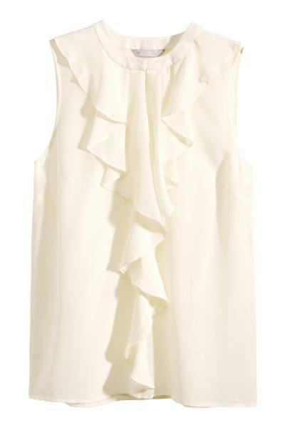 Blusa de seda sin mangas: ALTA CALIDAD. Blusa ajustada en seda morera con volantes y una pequeña abertura en la parte delantera. Botón oculto en la nuca. Sin mangas.