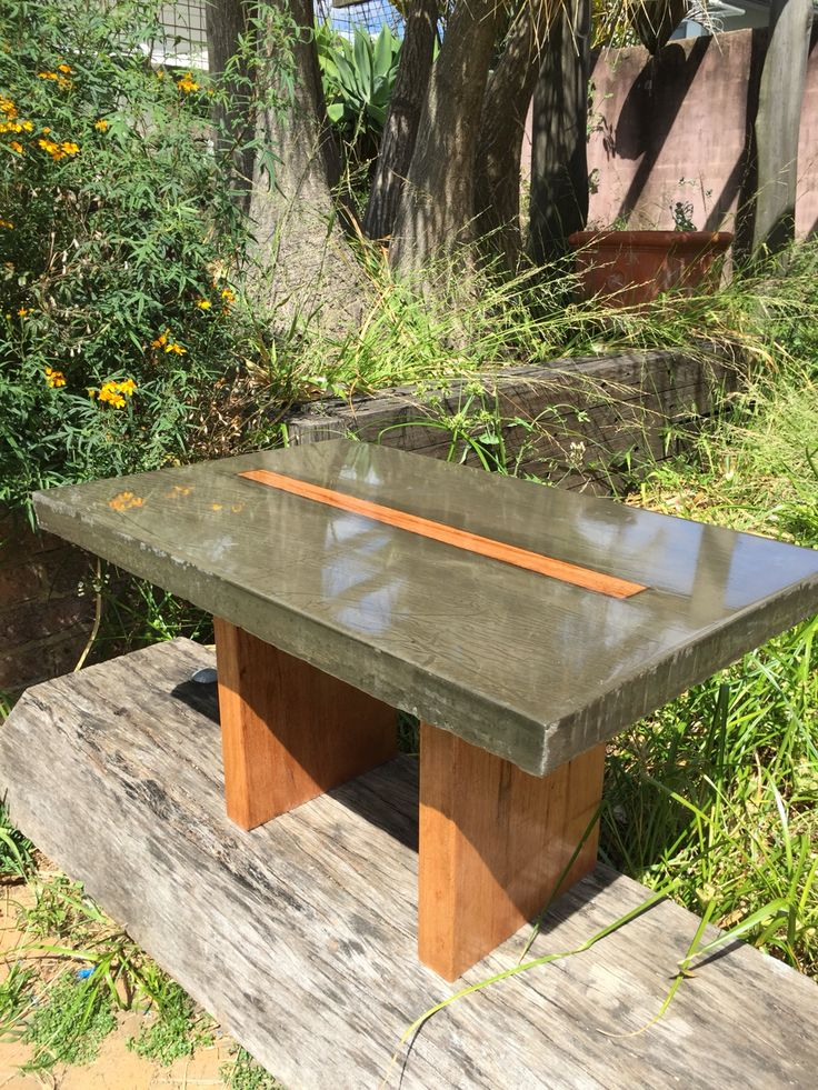 Coffee table made from concrete with Blackbutt highlights