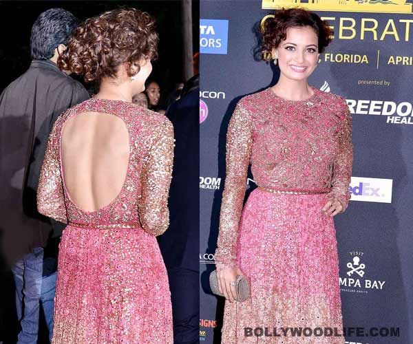http://www.musicyouluv.com/hindi-movie/  Dia Mirza looked her pretty self at IIFA Awards 2014! Dia Mirza was spotted in an embellished Sabyasachi outfit at IIFA Awards 2014. In the ombre pink and gold gown, Dia looked good but certainly not her best appearance. What we loved about her look was her hairdo. Did you like Dia in this outfit, peeps?