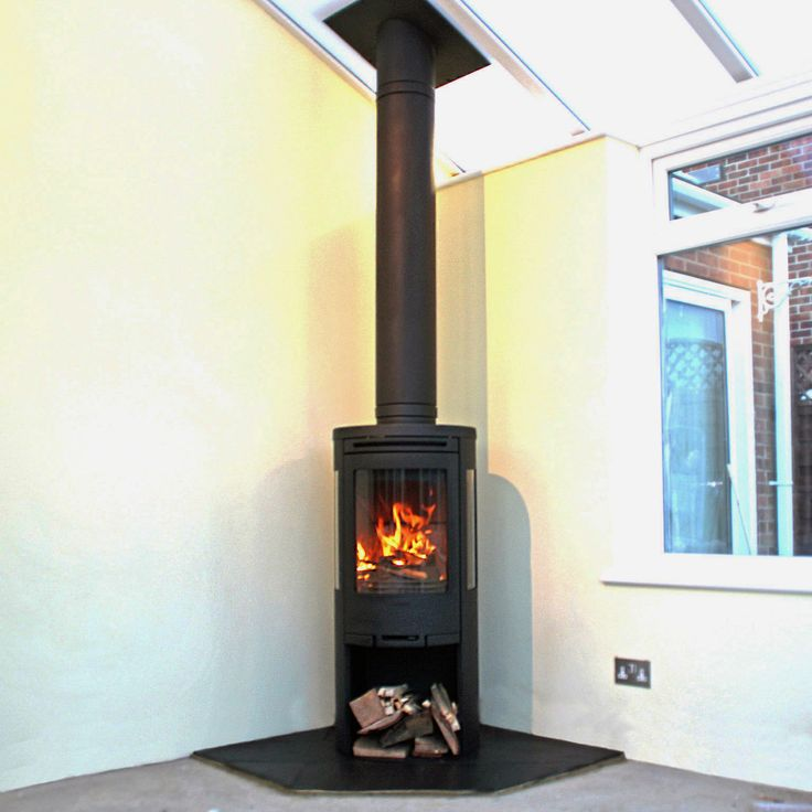 Contura 510 wood stove with slate hearth and Poujalait stainless steel insulated chimney system, Fitted in Eastwood Essex 2011