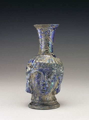 Flask in the Shape of a Head (Getty Museum)  Roman, A.D. 300 - 500   Mold-blown glass   6 3/4 x 3 1/8 in.   85.AF.320