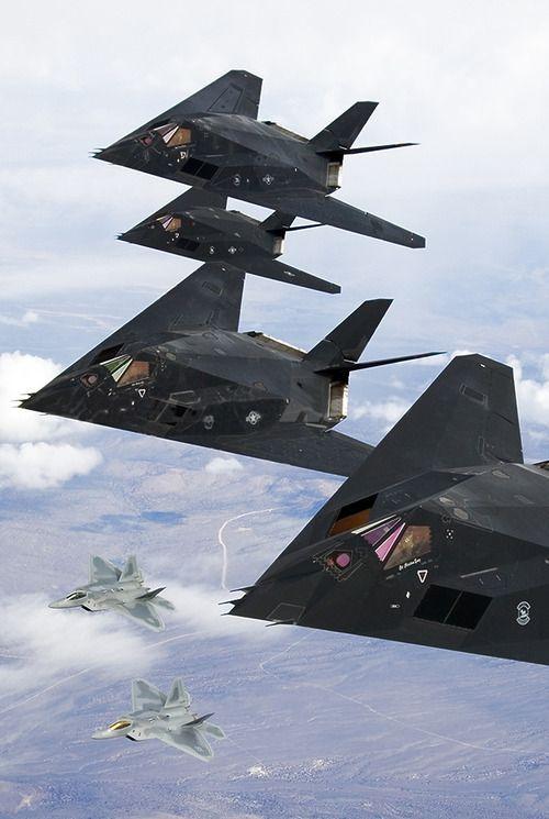 F-117 Nighthawk Stealth Flight with F-22 Raptors in flight formation.