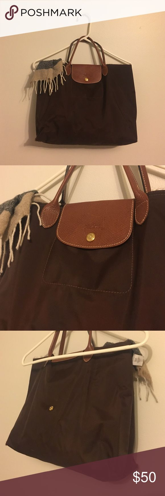 Longchamp medium size bag Purchased this chocolate brown medium sized bag in France so it is very authentic. It is the perfect bag to use on the go or what I used it for as a school bag. It does not have a zipper but a snap button. It can fit a small laptop in it. The bottom corners have small holes in them from wear and the top hem is slightly frayed but still almost as good as new! Longchamp Bags Totes