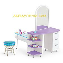 Salon Station for Dolls  Item# G0030 $85    She can treat her American Girl doll to a pampering session with this salon set! This set features everything she needs for make-believe spa treatments and salon styles:  A spa table with space for manicures and hairstyles, a mirror so she can check out her 'do, plus plenty of drawers and shelves  A chrome salon stool for her doll to perch on while she primps  Plenty of pretend salon supplies: five nail polish bottles, three flower-shaped nail…