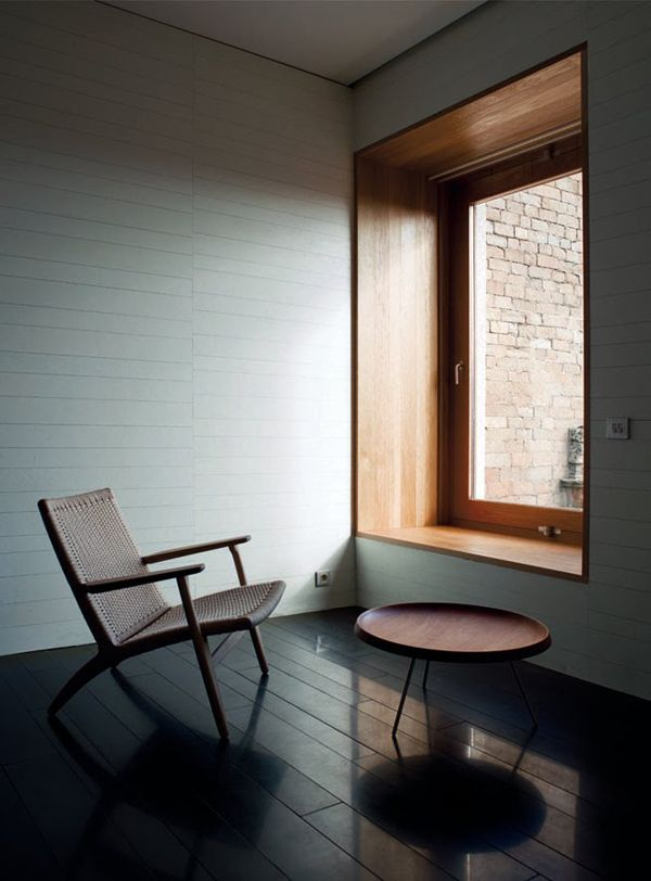 White wooden cladding in this reflective space.