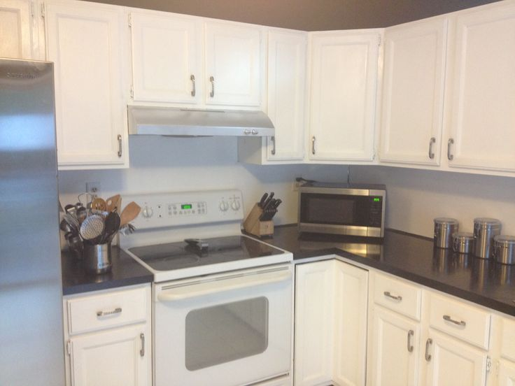 using rustoleum countertop coating + spray painted stove vent ...