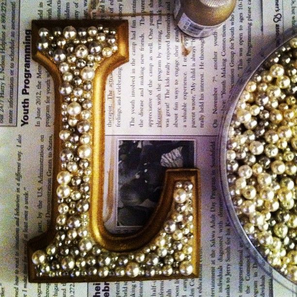 Wooden letters with pearls glued on. Love these for table numbers