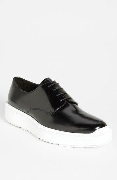 Prada Wedge derby shoes in shiny black leather with white chunky sole, sold out.