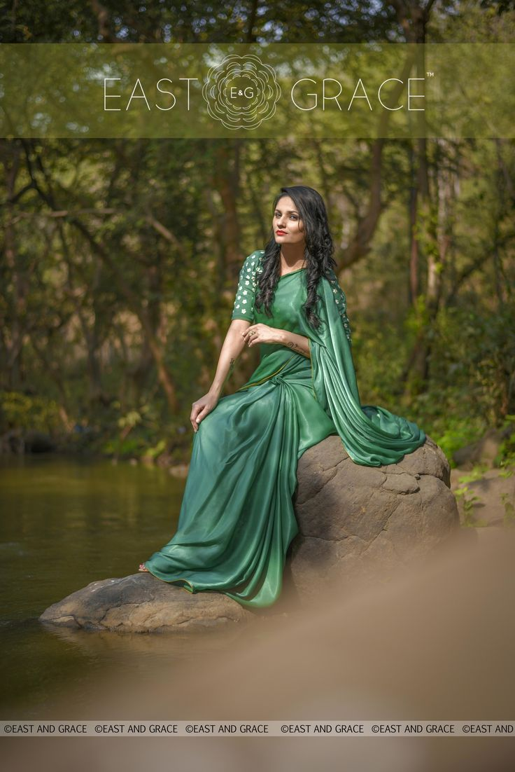 PRICE: INR 6,981.00; US$ 105.77 To buy click here: https://goo.gl/dfp2Jp Featuring the Sweet Pear green, pure satin georgette saree with darling white pear flower wreath embroidered at the back of the blouse. Tiny white florets are embroidered all over the blouse and the saree is accented with a thin mustard edging for a vintage-inspired effect. The satiny drape is delicious and comes with a luxe shimmer that you cannot go wrong with. Reach us at care@eastandgrace.com. www.eastandgrace.com