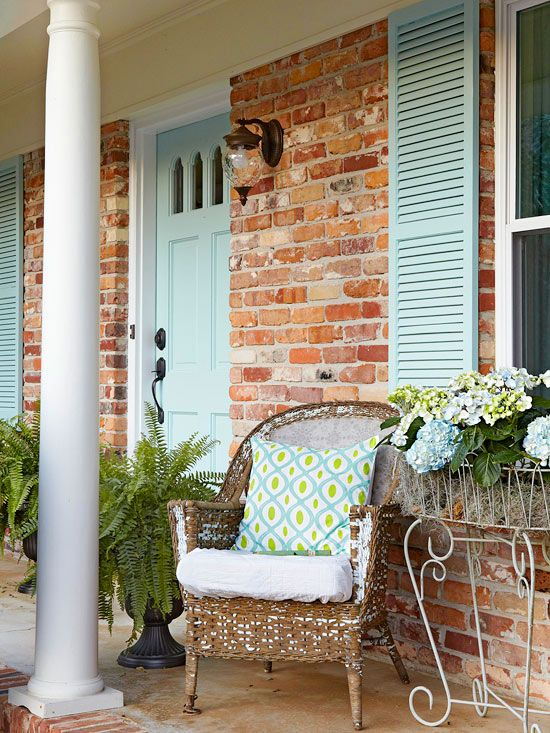 A pale blue door brightens this home's facade. More inexpensive ways to add curb appeal: http://www.bhg.com/home-improvement/exteriors/curb-appeal/curb-appeal-on-a-dime/?socsrc=bhgpin051513palebluedoor=2:
