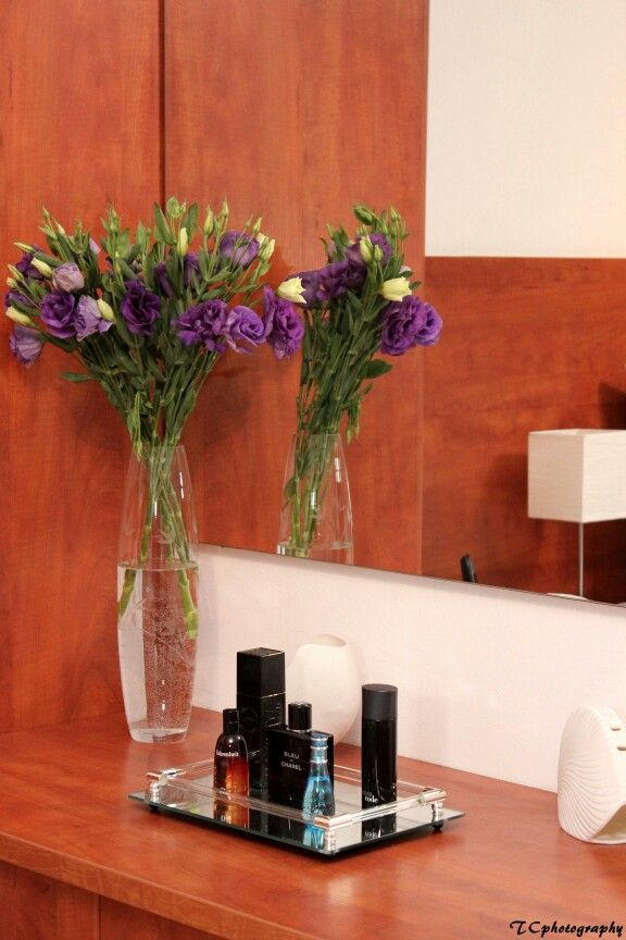 Flowers and perfume contribute to this #dressing-table's clean and sophisticated #design where less is more!