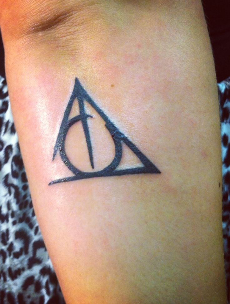 i love this version of the deathly hallows symbol... I'd just add :death is but the next great adventure.