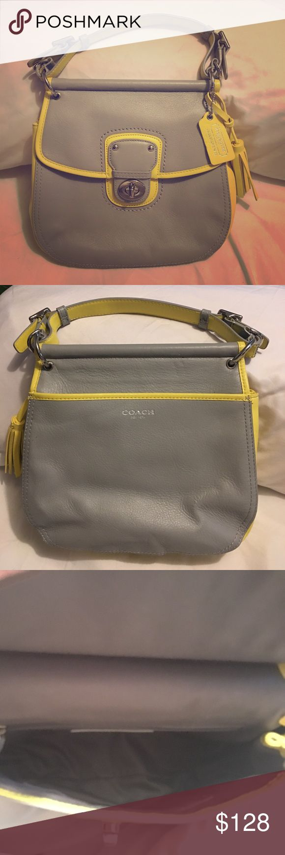 RARE COACH LEGACY ARCHIVAL HANDBAG COACH LEGACY ARCHIVAL. Two tone Willis Crossbody Handbag. MINT CONDITION!! Used ONE TIME. No interior or exterior damage. No longer sold in most stores and hard to find. Contrast bindings and tassels add definition to the design, giving it a heritage Coach look that is at once modern and classic. - MSRP $328.00. Coach Bags