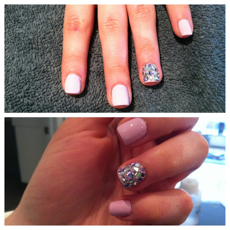 A Shellac Manicure with some gems added to one finger on each hand!  Wanted to make their nails stand out even more!