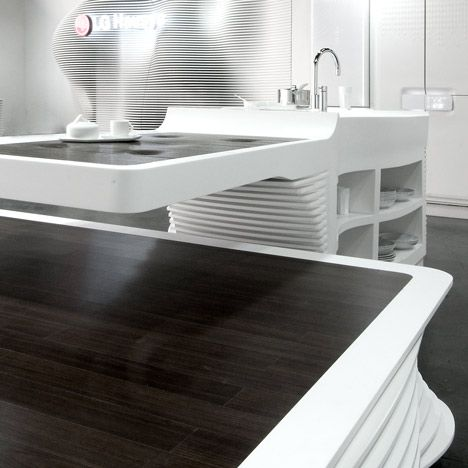 space kitchen w/ thermo-formed solid surfaces   HI-MACS is a solid surface material designed and produced by LG Hausys that can be thermoformed to any 3D shape.