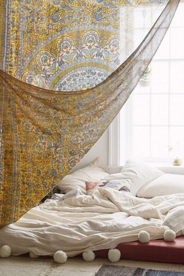 Bohemian bedroom. Beautiful scarf for door way