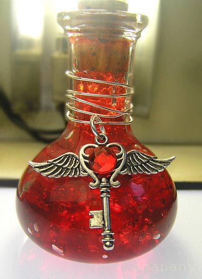Hearts:  #Love Potion ~ Ellaria's artifact is a magick bottle of healing. The winged key with the ruby is the cleric's holy symbol. By esanany.