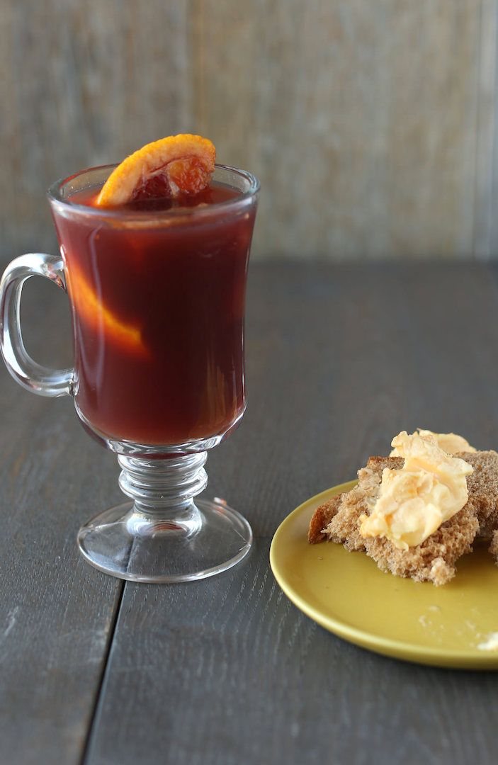 Mulled wine, a bold red wine-based drink that gets warmed up and steeped with orange zest and juice, cinnamon sticks, cloves and star anise, and sweetened with honey. Pair this with Stinking Bishop, the infamous English washed-rind cow's milk cheese.