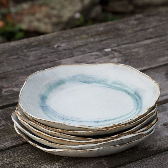 Ceramic dinner plate with circles in copper and blue, by Kara Miller.