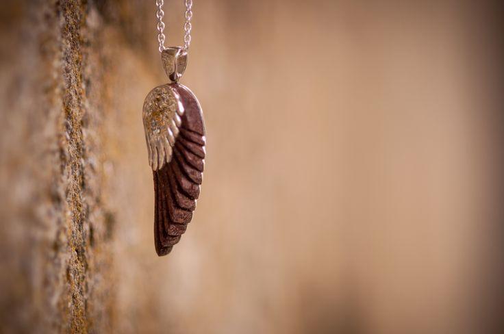 Jarrah (Australian Hardwood) wing pendant encased in Sterling Silver.