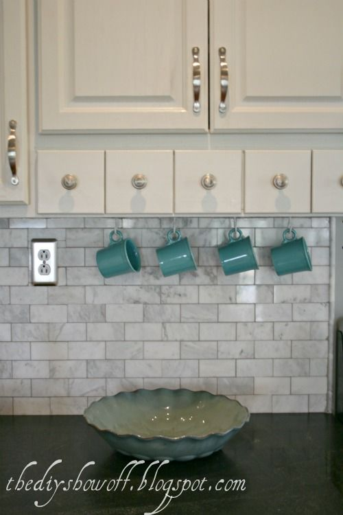 adding useful color to your kitchen with pretty coffee mugs and cup hooks. I know it's not a new invention, but it's a good one