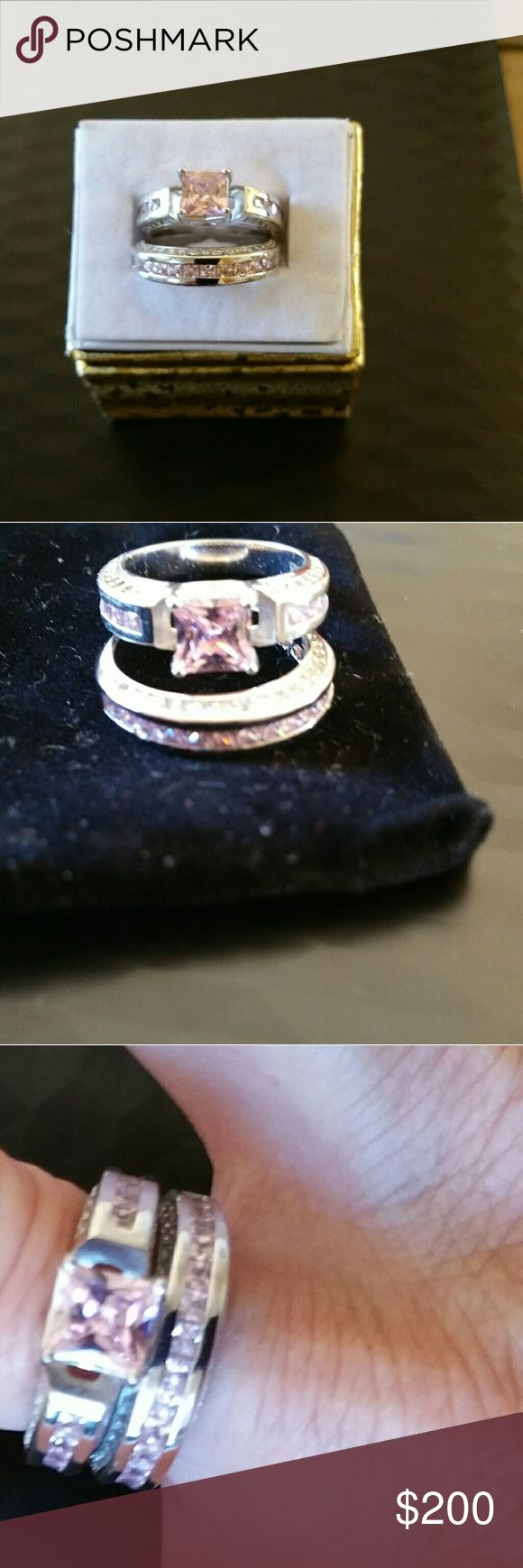 Engagement Ring Set Sterling Silver genuine through, 2 carat pink sapphire engagement ring , wedding band same with approximate 16 small pink sapphires on band.  I have to let go relationship a heartbreaker but set is beautiful girls. Please consider would bring me joy to help in your wedded bliss.. Jewelry Rings