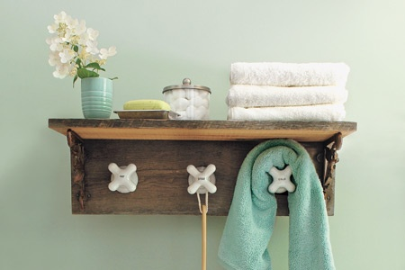 BATHROOM: Shelf with Vintage Faucet Hardware.