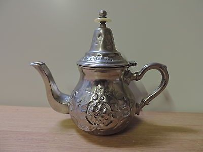 VINTAGE COFFEE POT ISLAMIC OR TURKISH MARKED SARTIC SA APPROX 7.5  (19 CM) HIGH X 9  (23 CM) FROM HANDLE TO SPOUT IN USED CONDITION - SHOWS SOME WEAR TO THE PLATE A THE SPOUT AND INSIDE