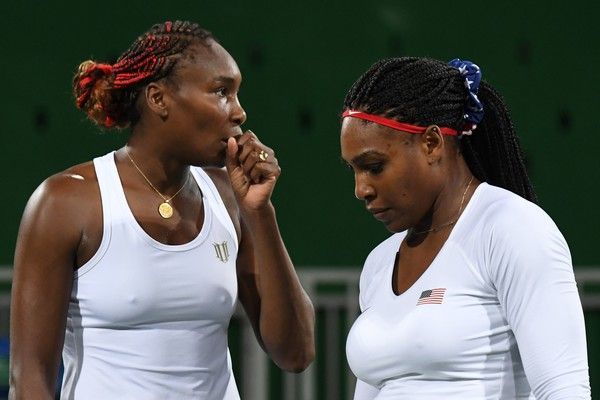 Venus Williams Serena Williams Photos Photos - USA's Venus Williams (L) speaks to USA's Serena Williams during their women's first round doubles tennis match against Czech Republic's Lucie Safarova and Czech Republic's Barbora Strycova at the Olympic Tennis Centre of the Rio 2016 Olympic Games in Rio de Janeiro on August 7, 2016. / AFP / Martin BERNETTI - Tennis - Olympics: Day 2