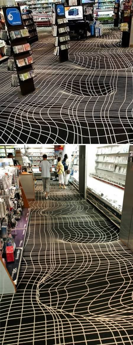 This optical illusion carpet, spotted in a Paris video game store, provides an illusion of a vortex floor. (http://www.moillusions.com/2011/09/illusion-carpet-in-the-game-store.html)