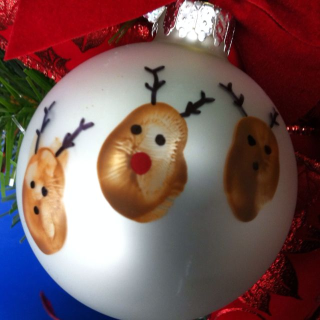 "I have done the ""well used snowmen ornament""...but this is new! Thumbprint Reindeer ornament. Kids names and ages on back."