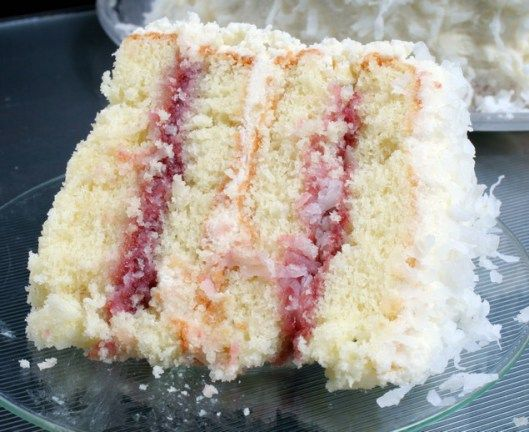 Coconut Cake with Raspberry Filling- The cake is very moist without being too dense and is so flavorful.