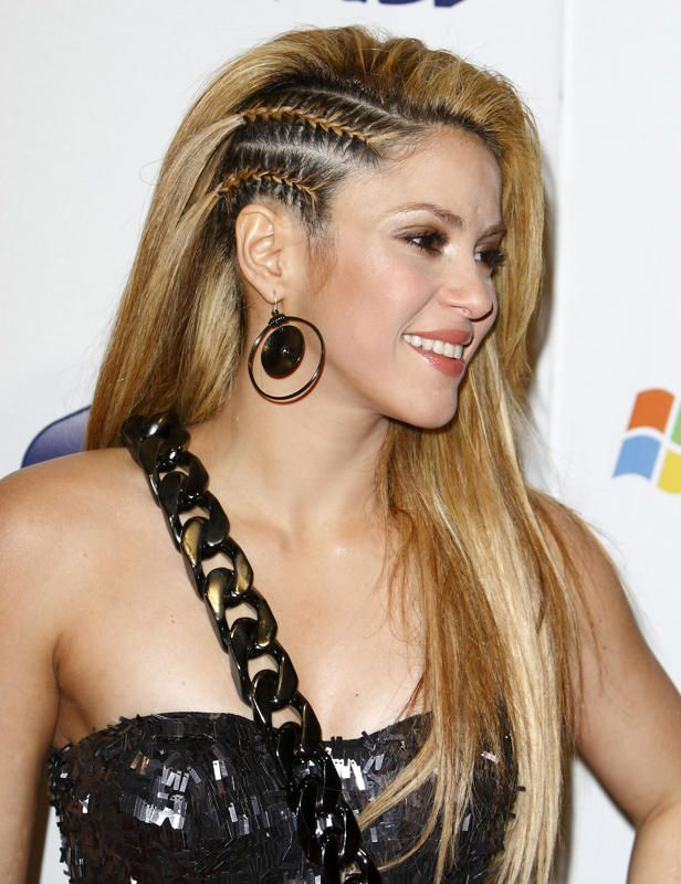shakira with long multitone colored hair swept to one