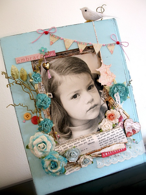 Altered book, Picture frame.  don't know that I would do that with a book, but this is really adorable!