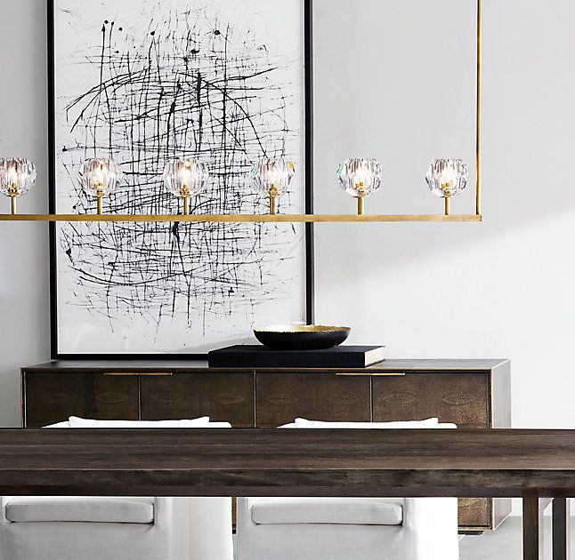 """RH's Boule De Cristal Linear Chandelier 60"""":Crafted of solid brass and crystal, lighting designer Jonathan Browning's sculptural fixture is a testament to his passion for luxe materials and superior handcraftsmanship. Evoking the minimalist spirit of 1960s design, each faceted sphere is ground and polished by hand to reflect and refract the light."""