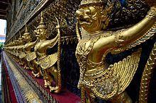 The statues of Krut battling naga serpent, a Thai Buddhist adaptation of Garuda in Wat Phra Kaeo temple, Bangkok