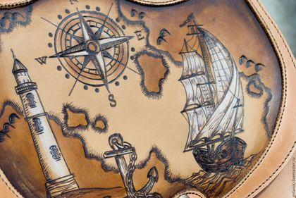 Купить или заказать Сумка кожаная женская через плечо Морское путешествие в интернет-магазине на Ярмарке Мастеров. Сумочка из приятной на ощупь, теплой и эластичной кожи премиум-класса. Рисунок на морскую тему с парусником и розой ветров нанесен вручную в технике выжигания, тонирован специализированными средствами. Рисунок стоек и долговечен. Наплечный ремень регулируется от 114 до 134 см, удобно лежит на плече. Сзади - кармашек. Сумка разделена на 2 достаточно вместительные отдела.
