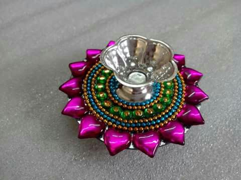 17 best images about rangoli on pinterest quilling for Candle decoration with waste material