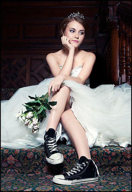 ウェディングドレス+スニーカー dress lifted over knees, legs at different levels, bouquet in hand rest over top knee, chin on other arm.