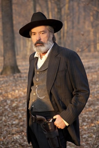 Powers Boothe as Wall Hatfield, brother of Devil Anse in Hatfields & McCoys
