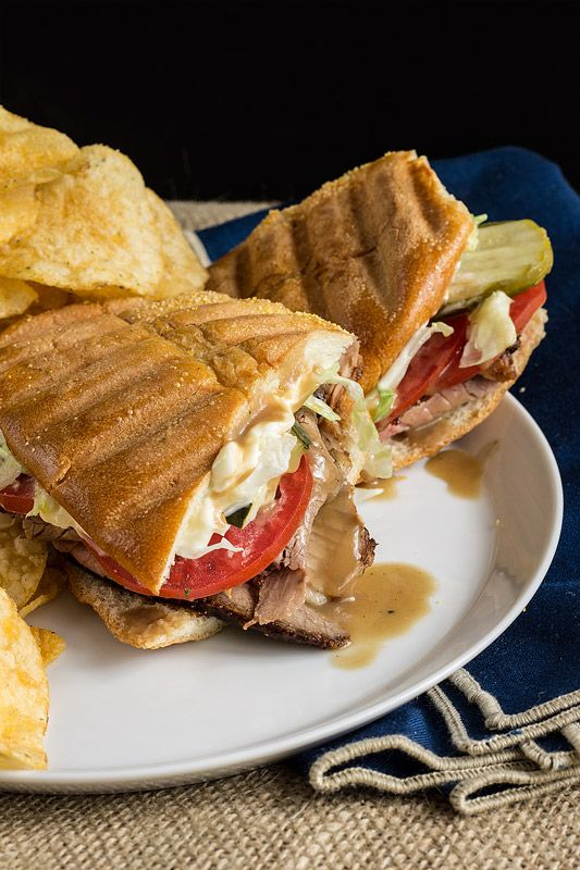 Mississippi Roast Beef Po'Boys: Thinly sliced roast beef piled atop split rolls, drizzled with gravy and dressed & pressed with all the fixins.