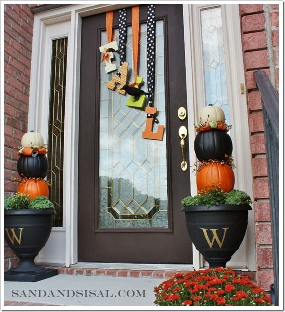 If you're looking to do something different than a typical wreath on your door, check out this great Fall Door Decor with block letters and ribbons! There's a tutorial on how to make it and the Pumpkin Topiary.