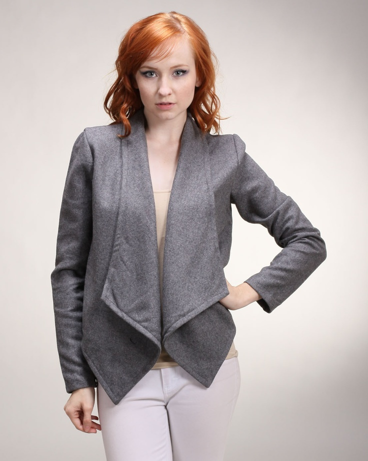Cheryl says: A great item to have in your closet is show stopping outerwear. This modern jacket with its charcoal tone will be your go-to piece when it comes to layering over other clothes. The open lapels hang low in the front, while the back of the jacket is cropped to perfection. The wool fabric also adds comfort to style.