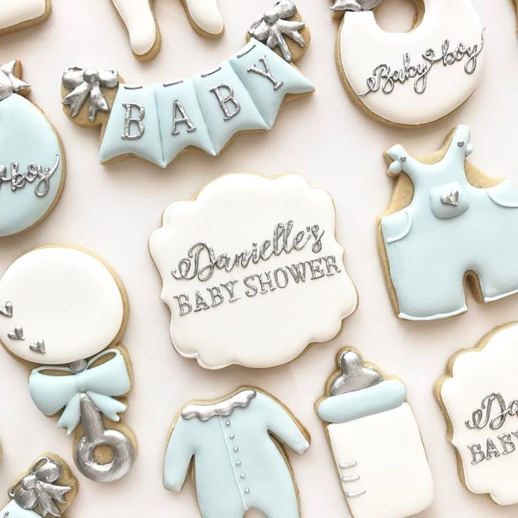 Nina Marie Sweet Designs | Baby Shower | Baby boy | custom cookies | biscuits | decorated cookies | pregnant | cookies | dessert | party favours | baby blue | silver | bottles | rattle | decorations | bunting | jumpsuit | bows |
