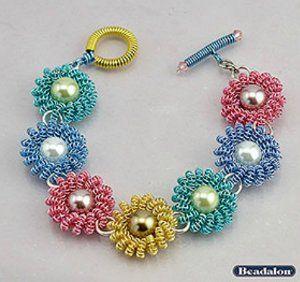 Coiled Wire Daisy Bracelet | AllFreeJewelryMaking.com