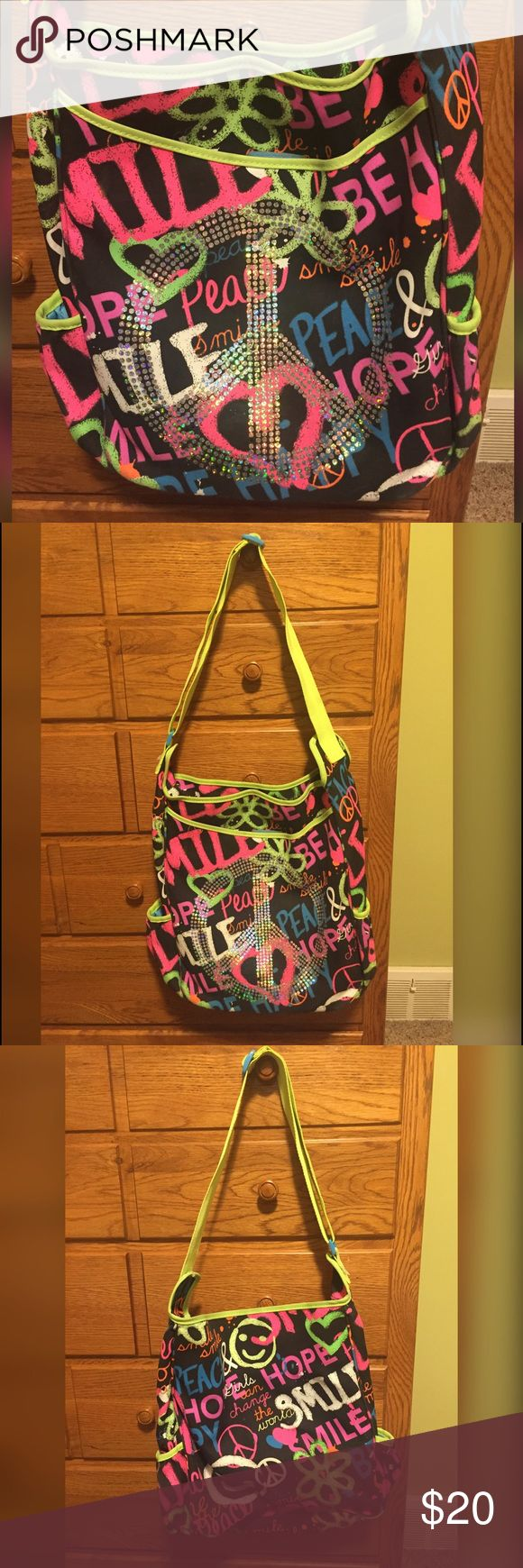 Justice Neon Graffiti Peace Bag Justice Neon Graffiti Peace Bag - Gently used - great for back to school - an overnight or just to tote things around. Has two side pockets, a front pocket that velcros and has a zipper closure on top. Justice Accessories Bags