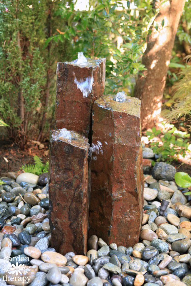Gorgeous columnar basalt disappearing fountain was installed as a DIY project. It was easier than you think!